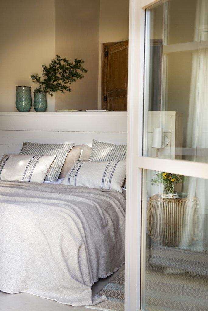 Dormitorio en tonos crudo